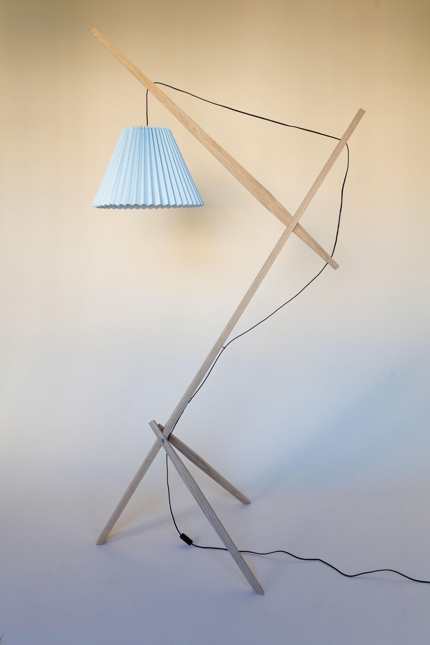 Gulvlampe kaldet Rosa lamp består af en trækonstruktion i dansk FSC-mærket eg fra et savværk i Enderslev, mens lampeskærmen i blå – Gert lampshade – er produceret på en dansk familieejet lampefabrik. Lampen har et højt og lidt ranglet design, der måske kan skabe associationer til en giraf eller en gammel dame. Designet er let og elegant og med et fokus på ledningen, som i designs oftest gemmes væk. Rosa lanceres med 4 forskellige skærmfarver i smukke pastelagtige farver nemlig blå, mint, salmon og hvid.