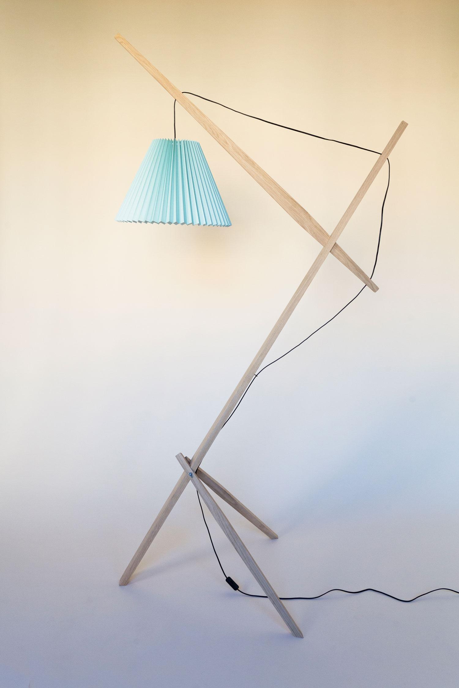 Gulvlampe kaldet Rosa lamp består af en trækonstruktion i dansk FSC-mærket eg fra et savværk i Enderslev, mens lampeskærmen i grøn – Gert lampshade – er produceret på en dansk familieejet lampefabrik. Lampen har et højt og lidt ranglet design, der måske kan skabe associationer til en giraf eller en gammel dame. Designet er let og elegant og med et fokus på ledningen, som i designs oftest gemmes væk. Rosa lanceres med 4 forskellige skærmfarver i smukke pastelagtige farver nemlig blå, mint, salmon og hvid.